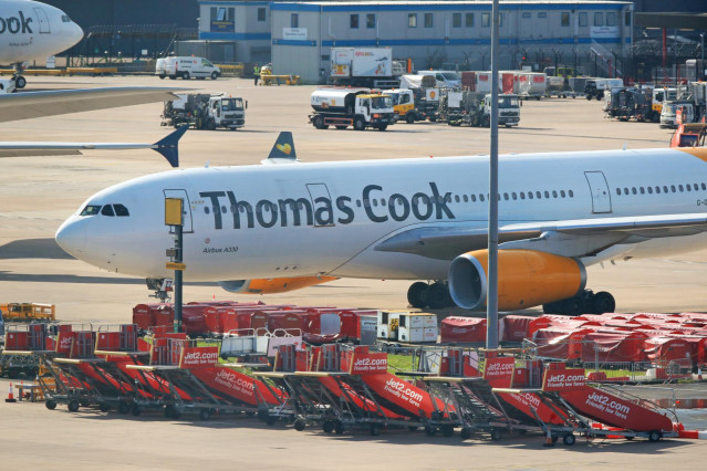 23 September 2019, England, Manchester: An Airbus A330 from the airline Condor with the design of the tourism company Thomas Cook stands on the tarmac at  Manchester Airport. Thomas Cook, one of Britain's biggest travel firms, filed for liquidation early